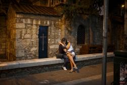 A couple kiss near the 11th century Greek's Orthodox Church of Panagia Kapnikarea, central Athens, on the early hours of Sunday, June 28, 2015. (AP Photo/Daniel Ochoa de Olza)