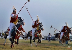 Pakistani horse riders target wooden pegs during a tent pegging competition arranged by the Pakistan Tent Pegging Association in Islamabad, Pakistan, June 14, 2015. (AP Photo/Anjum Naveed)