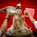 Buddhist devotees bathe a Buddha statue on Wesak Day, known as Buddha's birthday, at a temple in Petaling Jaya outside Kuala Lumpur, Malaysia on Sunday, May 3, 2015. Wesak Day, one of the holiest days for Buddhists, offers an opportunity for all followers to come together and celebrate not only Buddha's birthday, but also his enlightenment and achievement of nirvana. (AP Photo/Joshua Paul)