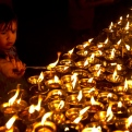 Indians light lamps to mark Buddha Purnima festival at the Karmapa International Buddhist Institute in New Delhi, India, Monday, May 4, 2015. The festival marks the triple events of Gautam Buddha's life: his birth, his enlightenment and his attaining a state of Nirvana that frees believers from the circle of death and rebirth. (AP Photo/Saurabh Das)