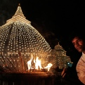 A Sri Lankan Buddhist devotee lights incense sticks as he marks the Vesak or Buddha Purnima at a temple in Colombo, Sri Lanka, Monday, May 4, 2015. The festival marks the triple events of Gautam Buddha's life: his birth, his enlightenment and his attaining a state of Nirvana that frees believers from the circle of death and rebirth. (AP Photo/Eranga Jayawardena)