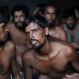 Bangladeshi migrants sit inside a temporary shelter upon arrival at Kuala Langsa Port in Langsa, Aceh province, Indonesia, Friday, May 15, 2015. Hundreds of Bangladeshi and ethnic Rohingya migrants have landed on the shores of Indonesia and Thailand after being adrift at sea for weeks, authorities said Friday. (AP Photo/Binsar Bakkara)