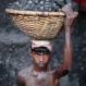 A Bangladeshi worker carries a basket of coal as he unloads it from a ferry at the Buriganga River in Dhaka, Bangladesh, Wednesday, April 29, 2015. (AP Photo/A.M. Ahad)