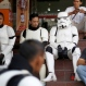 """Indonesian men dressed as """"Stormtroopers"""" from the movie """"Star Wars"""", take a break between performances during a promotional event at a shopping mall in Jakarta, Indonesia, Tuesday, May 19, 2015. (AP Photo/Dita Alangkara)"""