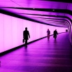 People walk through an underground passage leading out of King's Cross and St. Pancras underground tube station, London, Tuesday, May 5, 2015. Some 1.265 billion passenger journeys are made annually on London's underground subway network which opened in 1863. (AP Photo/David Azia)