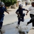 Riot police chase a demonstrator in Bujumbura, Burundi, Monday, May 4, 2015. Anti-government demonstrations resumed in Burundi's capital after a weekend pause as thousands continue to protest the president's decision to seek a third term. (AP Photo/Jerome Delay)