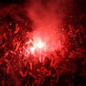 River Plate fans light a flare in the stands before the start of a Copa Libertadores soccer match against Argentina's Boca Juniors in Buenos Aires, Argentina, Thursday, May 7, 2015. (AP Photo/Victor R. Caivano)