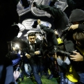 Marcelo Gallardo coach of River Plate, center, leaves the field protected by riot police after the match against Boca Juniors was suspended during a Copa Libertadores soccer match in Buenos Aires, Argentina, Friday, May 15, 2015. Conmebol authorities and referee Dario Herrera canceled the game after pepper spray was thrown from the stands towards River Plate players, before the start of the second half of the game. (AP Photo/Victor R. Caivano)