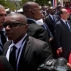 Bodyguards stand around France's President Francois Hollande, second from right, and Haiti's President Michel Martelly, right, during a flower laying ceremony at the statue of Haiti's Revolution leader Toussaint Louverture at the National Palace in Port-au-Prince, Haiti, Tuesday, May 12, 2015. Hollande is making the second visit ever by a sitting president of France to its once prized possession of Haiti, where bountiful resources and brutal plantation slavery made it the European nation's most profitable colony some 250 years ago. (AP Photo/Dieu Nalio Chery)