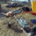 EDS NOTE GRAPHIC CONTENT - The bodies of men who authorities say were suspected cartel gunman lie next to farm equipment at the Rancho del Sol, near Ecuanduero, in western Mexico, Friday, May 22, 2015. At least 43 people died Friday in what authorities described as a fierce, three-hour gunbattle between federal forces and suspected drug gang gunmen at the ranch. (AP Photo/Oscar Pantoja Segundo)