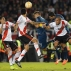 Jonathan Calleri of Boca Juniors, center, heads the ball during a Copa Libertadores soccer match against River Plate in Buenos Aires, Argentina, Thursday, May 7, 2015. (AP Photo/Victor R. Caivano)