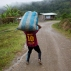 In this March 16, 2015 photo, Jhorlis Huallpa, 17, carries a bagful of tarps, to be used for drying coca leaves, in La Mar, province of Ayacucho, Peru. Hauling cocaine out of the valley is about the only way to earn decent cash in this economically depressed region where a farmhand earns less than $10 a day. Beyond extinguishing young lives, the practice has packed Peru's highland prisons with backpackers while their bosses evade incarceration. (AP Photo/Rodrigo Abd)
