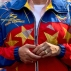 """Venezuela's first lady Cilia Flores wears a jacket made in the colors of Venezuela's flag during a May Day rally in Caracas, Venezuela, Friday, May 1, 2015. Flores' jacket reads her name, along with her official title """"Primera Combatiente."""" Instead of first lady, Flores' goes by the title """"First Fighter."""" (AP Photo/Fernando Llano)"""