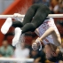 China's Shang Chunsong chalks the uneven bars before she competes at the Gymnastic World Challenge 2015 in Sao Paulo, Brazil, Saturday, May 2, 2015. (AP Photo/Andre Penner)