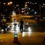 Youths walk down the street away from police in riot gear after a 10 p.m. curfew went into effect Thursday, April 30, 2015, in Baltimore. The curfew was imposed after unrest in the city over the death of Freddie Gray while in police custody. (AP Photo/David Goldman)