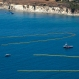 A helicopter coordinates ships below pulling booms to collect oil from a spill near Refugio State Beach, north of Goleta, Calif., Wednesday, May 20, 2015. A broken onshore pipeline spewed oil down a storm drain and into the ocean for several hours Tuesday before it was shut off. (AP Photo/Michael A. Mariant)