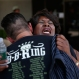 Shirley King, right, daughter of B.B. King, reacts as she hugs Roger Lewis outside of a funeral home during a memorial service for B.B. King Saturday, May 23, 2015, in Las Vegas. Friends and family members gathered Saturday at a funeral home to remember the Blues legend. (AP Photo/John Locher)