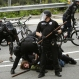Police arrest a protester as they clashed during a May Day anti-capitalism march Friday, May 1, 2015 in downtown Seattle. (AP Photo/Ted S. Warren)
