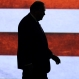 Former Arkansas Gov. Mike Huckabee enters a stage in Hope, Ark., before announcing his entry in the race for the Republican presidential nomination Tuesday, May 5, 2015. (AP Photo/Danny Johnston)