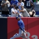 Kansas City Royals right fielder Paulo Orlando (16) leaps but can't catch a three-run home run ball hit by New York Yankees' Brian McCann during the first inning of a baseball game, Monday, May 25, 2015, in New York. (AP Photo/Julie Jacobson)