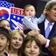U.S. Secretary of State John Kerry, right, holds 8-month-old Andrew Belz as he poses for photos with the children of U.S. troops and U.S. Embassy personnel at Collier Field House at Yongsan Garrison in Seoul, Monday, May 18, 2015. (Saul Loeb/Pool Photo via AP)