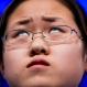 """Sophia Han, 14, of Tianjin, China, thinks about how to spell her word """"vermicide"""" during the 2015 Scripps National Spelling Bee, Wednesday, May 27, 2015, in Oxon Hill, Md. (AP Photo/Andrew Harnik)"""