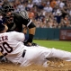 Houston Astros' Preston Tucker (20) slides safely into home plate as Chicago White Sox catcher Geovany Soto loses the ball during the fourth inning of a baseball game Saturday, May 30, 2015, in Houston. (AP Photo/David J. Phillip)
