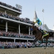 Victor Espinoza rides American Pharoah to victory in the 141st running of the Kentucky Derby horse race at Churchill Downs Saturday, May 2, 2015, in Louisville, Ky. (AP Photo/David J. Phillip)
