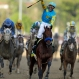 Victor Espinoza rides American Pharoah to victory in the141st running of the Kentucky Derby horse race at Churchill Downs Saturday, May 2, 2015, in Louisville, Ky. (AP Photo/Darron Cummings)