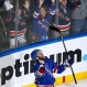 New York Rangers center Dominic Moore celebrates after scoring against the Tampa Bay Lightning during the third period of Game 1 of the Eastern Conference final during the NHL hockey Stanley Cup playoffs, Saturday, May 16, 2015, in New York. The Rangers won 2-1. (AP Photo/Julie Jacobson)