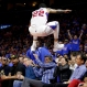 Los Angeles Clippers forward Matt Barnes leaps over a row of fans while chasing a loose ball during the second half of Game 3 in a second-round NBA basketball playoff series against the Houston Rockets, Friday, May 8, 2015, in Los Angeles. (AP Photo/Jae C. Hong)