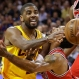 Cleveland Cavaliers guard Kyrie Irving (2) passes off the ball as Chicago Bulls guard Derrick Rose defends during the second half of Game 5 in a second-round NBA basketball playoff series Tuesday, May 12, 2015, in Cleveland. (AP Photo/Tony Dejak)