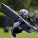 New Orleans Saints safety Pierre Warren hits a pylon during an NFL football organized team activity in Metairie, La., Thursday, May 28, 2015. (AP Photo/Gerald Herbert)