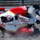 The car driven by Helio Castroneves, of Brazil, lands on the track after flipping after hitting the wall in the first turn during practice for the Indianapolis 500 auto race at Indianapolis Motor Speedway in Indianapolis, Wednesday, May 13, 2015. (AP Photo/Tom Hemmer)