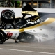 The car driven by Josef Newgarden slides down the track after hitting the wall in the first turn and going airborne during practice for the Indianapolis 500 auto race at Indianapolis Motor Speedway in Indianapolis, Thursday, May 14, 2015. (AP Photo/Joe Watts)