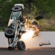 Ed Carpenter hits the wall in the second turn during practice before qualifications for the Indianapolis 500 auto race at Indianapolis Motor Speedway in Indianapolis, Sunday, May 17, 2015. Carpenter walked away from the crash and has been released from he track hospital after being checked. (AP Photo/Greg Huey)