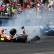 Stefano Coletti, of Monaco, middle, hits the car driven by Sebastian Saavedra, of Colombia, as Jack Hawksworth, right, of England, hits the wall in the closing laps of the 99th running of the Indianapolis 500 auto race at Indianapolis Motor Speedway in Indianapolis, Sunday, May 24, 2015. (AP Photo/Kirk Stierwalt)