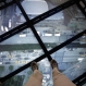 A view through the Sky Portal shows a live video view of the streets below from One World Observatory, Wednesday, May 20, 2015, in New York. Visitors can stand on a round video platform that shows an actual livestream of the view straight down. (AP Photo/Mark Lennihan)