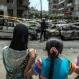 Egyptian children look towards the site of a bombing that killed Egypt's top prosecutor, Hisham Barakat, in Cairo, Egypt, Monday, June 29, 2015. (AP Photo/Eman Helal)