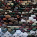 A Pakistani vendor waits for customers to sell caps in Karachi, Pakistan, Wednesday, June 17, 2015. Muslims throughout the world mark the month of Ramadan, the holiest month in the Islamic calendar, with dawn to dusk fasting. It is customary in some countries to wear caps when offering prayers in mosques. (AP Photo/Shakil Adil)
