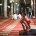 A father plays with his daughter after Friday afternoon prayers in Al-Azhar Mosque in the Islamic Cairo neighborhood, in Cairo, Egypt, Friday, June 5, 2015. (AP Photo/Mosa'ab Elshamy)