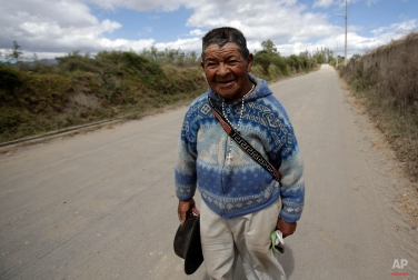 In this June 24, 2015 photo, an elderly Quichua Catholic Indian man wears a strand of rosary beads around his neck, in Piaba Chupa, Ecuador. (AP Photo/Dolores Ochoa)