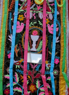 This June 7, 2015 photo shows an embroidered collage of Catholic and indigenous symbols that intermingle on a dancer's costume, in Pujili, Ecuador. (AP Photo/Dolores Ochoa)