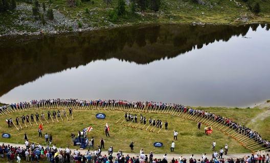Alpenhorn players prepare to perform along the Lac de Tracouet, situated 2200 meters (7220 feet) above sea level in Haute-Nendaz, canton of Valais, Switzerland, Sunday, July 26, 2015. (AP Photo/David Azia)