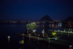 In this July 13, 2015 photo, athletes practice rowing on a deck in the Rodrigo de Freitas Lake in Rio de Janeiro, Brazil. Over 10,000 athletes from 205 countries are expected to compete in next year's Olympics games. Nearly 1,400 of them will be sailing in the waters near Marina da Gloria in Guanabara Bay, swimming off Copacabana Beach, and canoeing and rowing on the brackish waters of the Rodrigo de Freitas Lake. (AP Photo/Leo Correa)