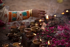 A Pakistani Muslim devotee lights oil clay lamps at a local shrine in suburbs of Islamabad, July 23, 2015. People usually visit shrines on Thursday and Friday to get their wishes fulfilled. (AP Photo/B.K. Bangash)