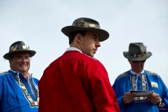 Alpenhorn players wearing traditional Swiss outfits stand near the Lac de Tracouet, situated 2200 meters (7220 feet) above sea level in Haute-Nendaz, canton of Valais, Switzerland, Sunday, July 26, 2015. (AP Photo/David Azia)