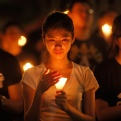 People attend a candlelight vigil at Victoria Park in Hong Kong Thursday, June 4, 2015. Tens of thousands of Hong Kongers joined the candlelight vigil Thursday night marking the crushing of the 1989 student-led Tiananmen Square protests, an annual commemoration that takes on greater meaning for the city's young after last autumn's pro-democracy demonstrations sharpened their sense of unease with Beijing. (AP Photo/Vincent Yu)