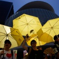 Pro-democracy protesters hold yellow umbrellas during a rally outside the Legislative Council in Hong Kong Thursday, June 18, 2015. The Hong Kong government's controversial Beijing-backed election reforms were defeated Thursday by pro-democracy lawmakers. (AP Photo/Kin Cheung)