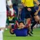 Japan's Shinji Okazaki, center, reacts as he tumbled on the pitch during their friendly soccer match against Iraq in Yokohama, south of Tokyo, Thursday, June 11, 2015. (AP Photo/Shuji Kajiyama)